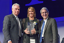 Yale President Peter Salovey and Athletics Director Thomas A. Beckett presenting Ginny Gilder '79. Yale Athletics Blue Leadership Ball & George H.W. Bush '48 Lifetime of Leadership Awards. 20 November 2015 at the William K. Lanman Center, Payne Whitney Gymnasium, Yale University.