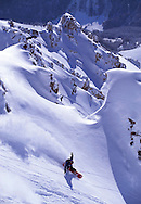FemaleSnowboarder turning in fresh powder snow, St Anton am Arlberg, Austria