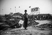 A Rohingya boy stands with a kite in Jamtoli refugee camp, Bangladesh (October 26, 2017)