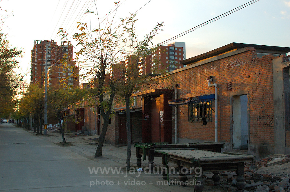 China, Beijing, Ping Fang Xiang, 2008. Sunset along one of Ping Fang Xiang's outlying streets, with the new development of Ding Fu Jia Yuan in the distance..
