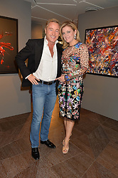 MICHAEL FLATLEY and his wife NIAMH at a private view of paintings by Michael Flatley entitled Firedance held at 12 hay Hill, London on 24th June 2015.