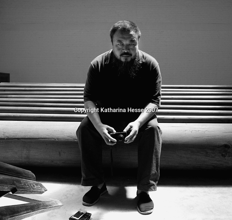 """BEIJING, MAY- 18 : Chinese artist Ai Weiwei, 50,  poses in his studio days before he leaves for the Documenta art exhibition in Germany . Ai will bring 1001 of his compatriots to Germany to spend months wandering around the city of Kassel as live exhibits for his entry to a leading modern art show...His """" Fairytale""""  artwork would cost  EU 3,1-million, the most expensive project of 2007's Documenta exhibition."""