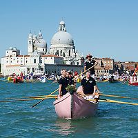 VENICE, ITALY - MAY 12:  A rowing boat sails in front of La Salute during the Sensa procession on May 12, 2013 in Venice, Italy. The festival of la Sensa is held in May on the Sunday after Ascension Day and follows a reenactment of the traditional ceremony where the Doge (Duke) enacted the wedding of Venice to the sea.  (Photo by Marco Secchi/Getty Images)