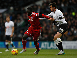 Kenwyne Jones of Cardiff City (L) and George Thorne of Derby County in action - Mandatory byline: Jack Phillips / JMP - 07966386802 - 21/11/2015 - FOOTBALL - The iPro Stadium - Derby, Derbyshire - Derby County v Cardiff City - Sky Bet Championship