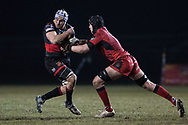Dragons' Ollie Griffiths holds onto the ball despite the attentions of Edinburghs' Lewis Carmichael.<br /> <br /> Photographer Simon Latham/Replay Images<br /> <br /> Guinness PRO14 - Dragons v Edinburgh - Friday 23rd February 2018 - Eugene Cross Park - Ebbw Vale<br /> <br /> World Copyright &copy; Replay Images . All rights reserved. info@replayimages.co.uk - http://replayimages.co.uk