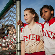 Gar-Field's (Woodbridge, VA) Ginger Scott, left, and Natalie Cowan watch a teammate at bat, during a game against Forest Park.  For The Prince William Times