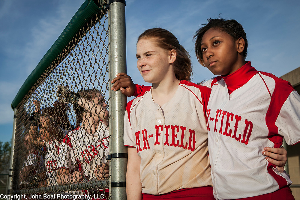 Gar-Field's (Woodbridge, VA) Ginger Scott, left, and Natalie Cowan watch a teammate at bat, during a game against Forest Park, on Thursday, April 24, 2014.  For The Prince William Times