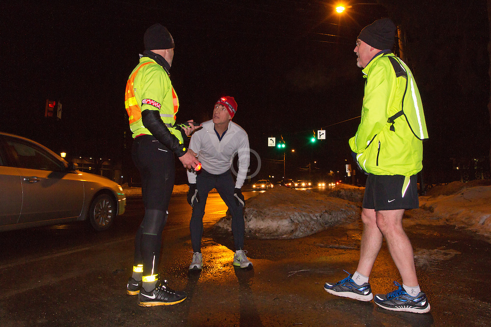 Gary Allen runs from Maine to Washington DC, turning off GPS tracker after finishing day three at intersection of Bath Road and Federal Street in Brunswick with Dwight Blease and Bill Goodrich