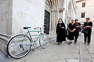 Women and bicycle outside the Cathedral of St Anastasia (Sv Stosija), Zadar, Croatia