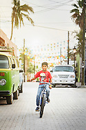 A Mexican boy demonstrates his bicycle riding skills on the streets of Todos Santos, Baja California Sur, Mexico.