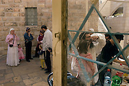 Family members and friends arrive for a new born boy's Brit Milla (circumcision) ceremony in Hebron's Jewish community..Hebron, Israel. 05/11/207.Photo © J.B. Russell/Blue Press