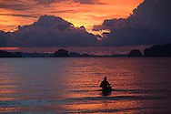 Fisherman at sunset, Phang Nga Bay/Andaman Sea, Thailand.
