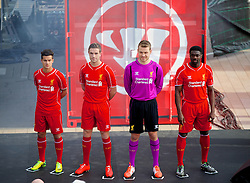 LIVERPOOL, ENGLAND - Thursday, April 10, 2014: Liverpool players Philippe Coutinho Correia, Jordan Henderson, goalkeeper Simon Mignolet and Kolo Toure launch the new Warrior home kit for 2014/2015 at the Liverpool One shopping centre. (Pic by David Rawcliffe/Propaganda)