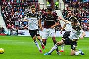 Paul Quinn makes a vital tackle against Osman Sow during the Ladbrokes Scottish Premiership match between Heart of Midlothian and Aberdeen at Tynecastle Stadium, Gorgie, Scotland on 20 September 2015. Photo by Craig McAllister.