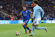 Leicester City Danny Simpson (2) closes in to tackle Manchester City midfielder Leroy Sane (19) during the Premier League match between Leicester City and Manchester City at the King Power Stadium, Leicester, England on 18 November 2017. Photo by Jon Hobley.