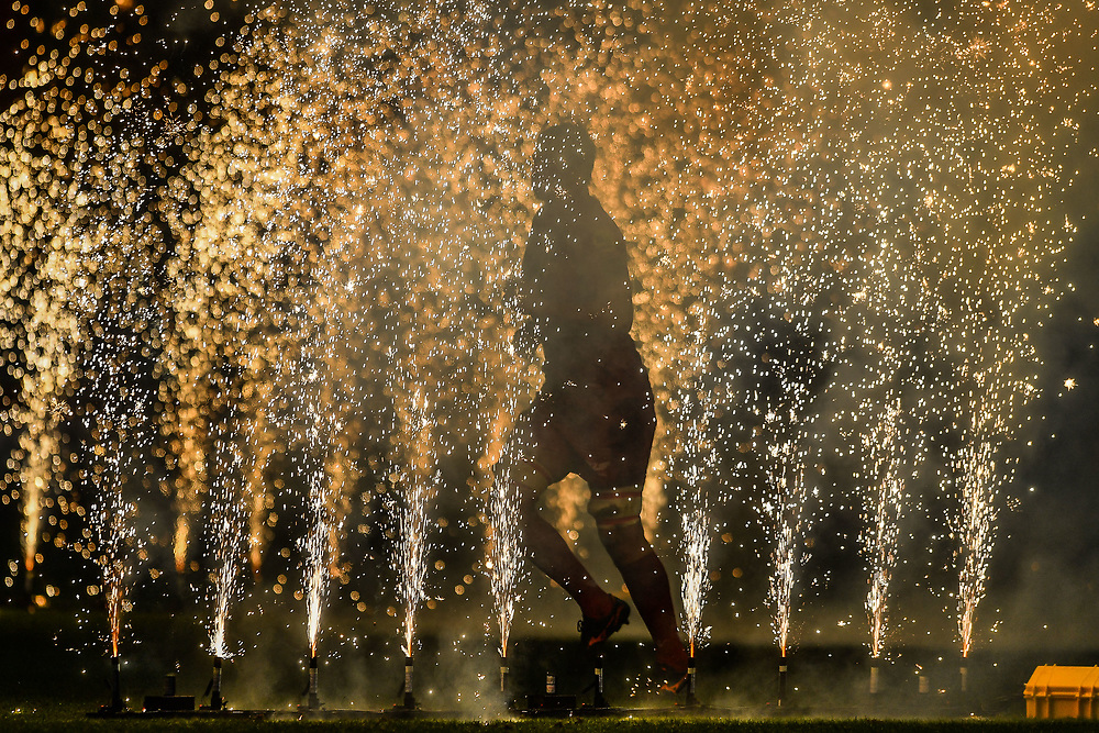 A Scarlets player enter the pitch through fireworks<br /> <br /> Photographer Craig Thomas/Replay Images<br /> <br /> Guinness PRO14 Round 17 - Scarlets v Leinster - Friday 9th March 2018 - Parc Y Scarlets - Llanelli<br /> <br /> World Copyright © Replay Images . All rights reserved. info@replayimages.co.uk - http://replayimages.co.uk