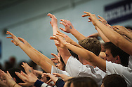 MMU fans hold up their hands during a free throw during the first round of the boys high school basketball playoffs between the Colchester Lakers and the Mount Mansfield Cougars at MMU High School on Tuesday night February 16, 2016 in Jericho. (BRIAN JENKINS/for the FREE PRESS)