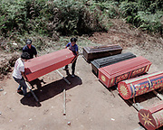 Family members put back the coffins containing the body of their dead relatives back in the tomb after cleaning and grooming.<br /> <br /> Ma'nene is a tradition that takes place in August after harvest where the bodies of the dead loved ones are exhumed to be cleaned, groomed and dressed. For most, it's a bittersweet moment, a chance to reunite and physically see and touch and reconnect with loved ones who had passed on.