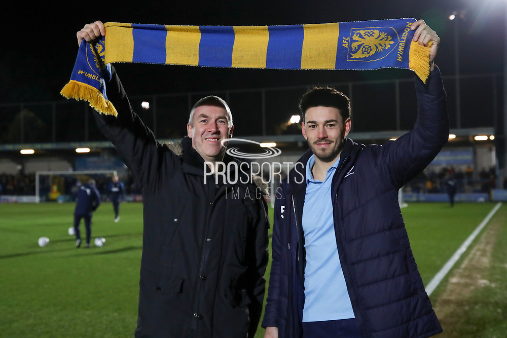 AFC Wimbledon defender Will Nightingale (5) holding up scarf during the EFL Sky Bet League 1 match between AFC Wimbledon and Burton Albion at the Cherry Red Records Stadium, Kingston, England on 28 January 2020.