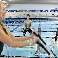 Adam Robison | BUY AT PHOTOS.DJOURNAL.COM<br /> Jenea Britton and Lauren Reddout, both of Tupelo, follow the lead of Kristi Paxton, yoga instructor for Bogafit, as they work on arm curls during their Bogafit workout Monday morning at the Tupelo Aquatic Center. Bogafit is yoga on-mats-in-the-pool exercise program and is controlled instability to help build better core strength.