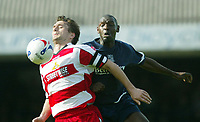Photo: Chris Ratcliffe.<br />Southend United v Doncaster Rovers. Coca Cola League 1. 22/04/2006.<br />Shaun Goater (R) of Southend is beaten to the ball by Graeme Lee of Doncaster