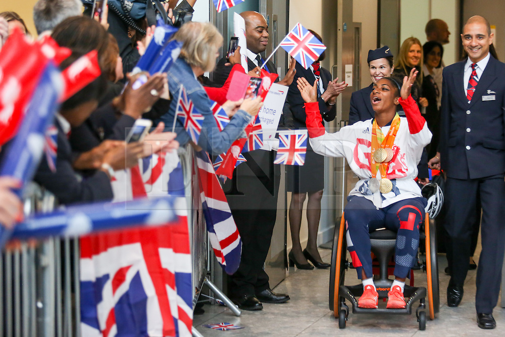 © Licensed to London News Pictures. 20/09/2016. London, UK. Team GB Paralympian KADEENA COX arrives at terminal 5 of London Heathrow Airport after flying on British Airways flight BA2016. Cox carried the GB flag at the closing ceremony after becoming the first Briton in 28 years to win medals in two sports (track cycling and athletics) at the same Paralympics. Team GB finished second in the Paralympics medals table with 147 medals beating their total of 120 at London 2012. Photo credit : Tom Nicholson/LNP
