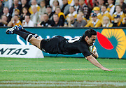 All Black halfback Piri Weepu dives across the tryline.<br />