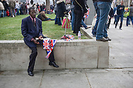 A man with flags in Parliament Square, London, awaiting the arrival of guests and members of the British royal family prior to the wedding of Prince William to Catherine Middleton. The wedding was held at Westminster Abbey. Tens of thousands of people lined the streets to wish the couple well before and after the ceremony.