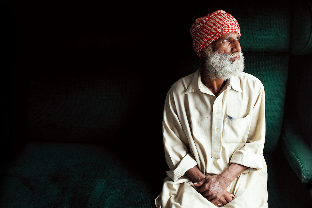 Haji Ghulam Abbas, seventy years old sits on the Khyber Mail traveling from Rawalpindi to Karachi on August 13, 2011. He is traveling from Dare Ghazi Khan to Hyderabad and has been working as a beggar in the train station all his life.