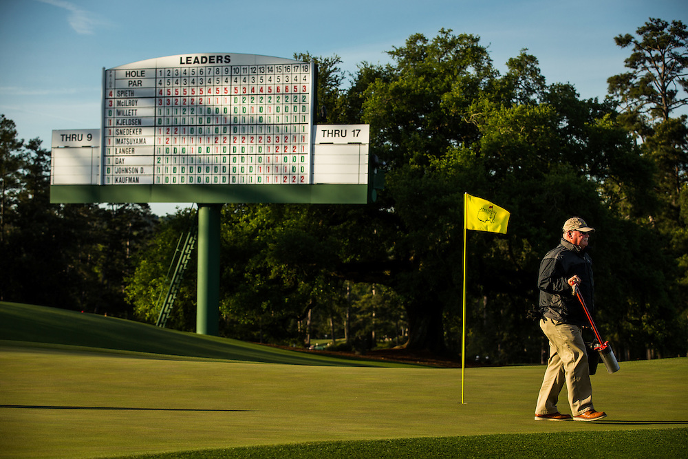 A member of the grounds staff leaves the 18th green after cutting the hole prior to the final round of the 2016 Masters Tournament. Golf: 2016 Masters<br /> Round 4 Sunday<br /> Augusta National/Augusta, GA, USA<br /> 04/10/2016<br /> SI-14 TK4<br /> Credit: Darren CarrollGolf: 2016 Masters<br /> Round 4 Sunday<br /> Augusta National/Augusta, GA, USA<br /> 04/10/2016<br /> SI-14 TK4<br /> Credit: Darren Carroll