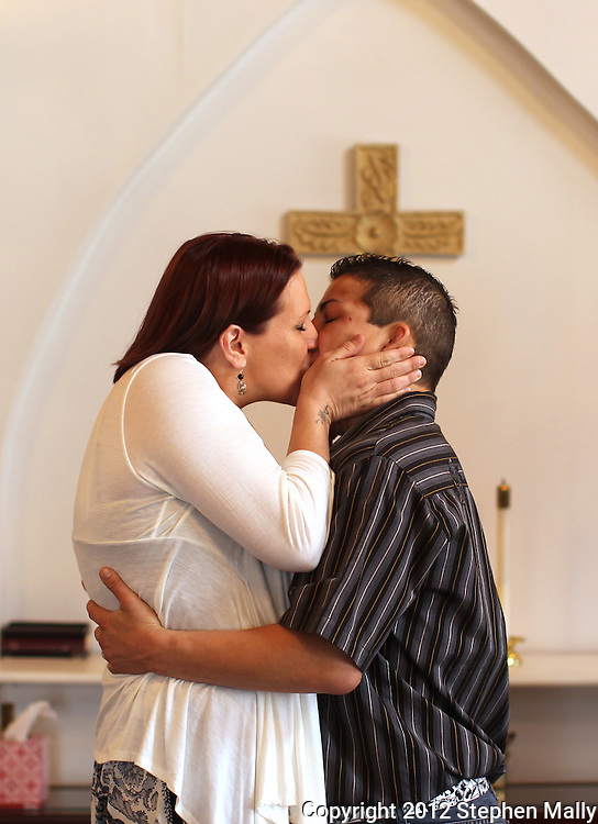 Brigg McDonald (from left) and Stephany Lee kiss during their ceremony at a wedding chapel in Cedar Rapids on Monday, April 23, 2012.