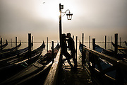 Two lovers kiss in Venice (models: Katherine Mulligan and Peter Havercroft, releases signed.