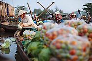 A woman sells produce in the Cai Rang floating market in Can Tho, Vietnam.
