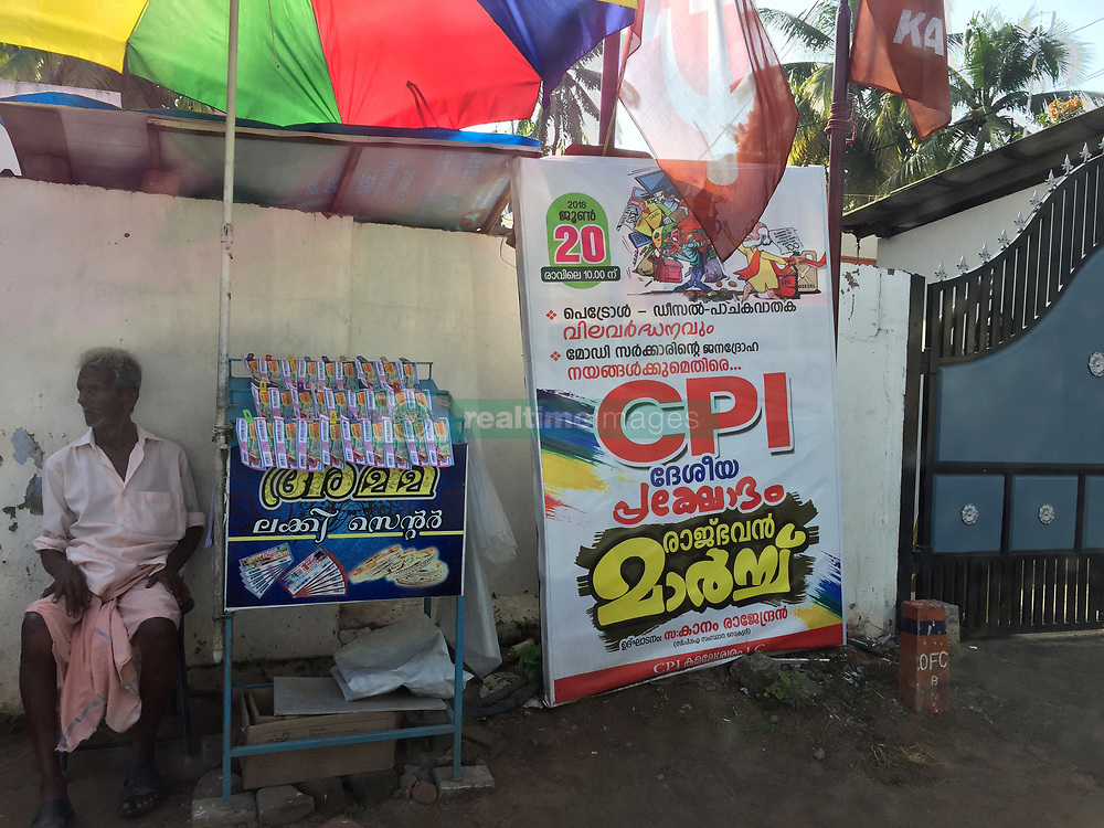 July 25, 2018 - Thiruvananthapuram, Kerala, India - Man selling lottery tickets by a poster for the Communist Party of India in the city of Thiruvananthapuram (Trivandrum), Kerala, India. (Credit Image: © Creative Touch Imaging Ltd/NurPhoto via ZUMA Press)