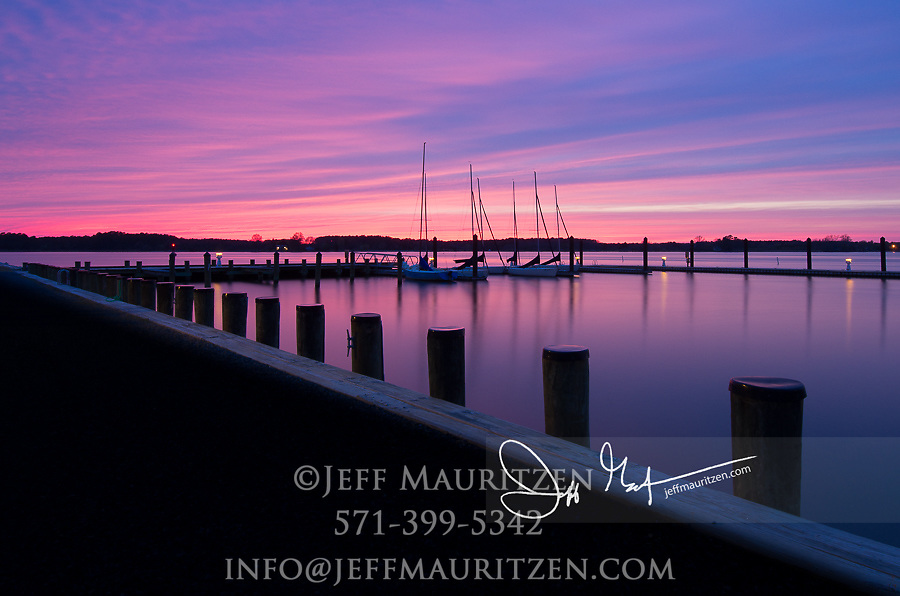 Sunset behind sailboats docked in Oxford, Maryland.