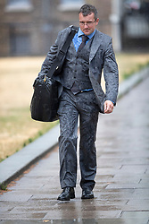 © Licensed to London News Pictures. 27/07/2018. London, UK. A man's suit is covered in rain splashes after a sudden downpour near Parliament as heavy rain ends the long dry spell. Photo credit: Peter Macdiarmid/LNP