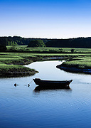 Dory moored in the Herring River, Harwich, Cape Cod, Massachusetts, USA.