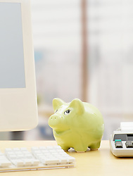 Dec. 14, 2012 - Piggy bank on a desk (Credit Image: © Image Source/ZUMAPRESS.com)