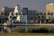 Palm tree lined waterfront and city high rise office buildings in downtown, Long Beach Harbor, California