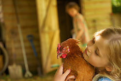 Girl Hugging Chicken