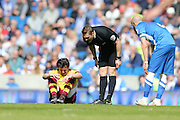 Burnley midfielder Joey Barton (13) injured during the Sky Bet Championship match between Brighton and Hove Albion and Burnley at the American Express Community Stadium, Brighton and Hove, England on 2 April 2016.