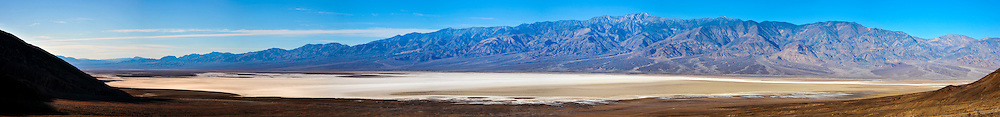 United States, California, Death Valley. Panorama view over Badwater Basin from Natural bridge road. Early in the morning,  the sun rises.