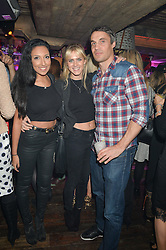 Left to right, LAURA INNES-HOPKINS, REBECCA WOODHEAD and ADAM BIDWELL at a party to celebrate the opening of Beaver Lodge, a new bar & club from the Inception Group at 266 Fulham Road, London SW10 on 4th December 2014.