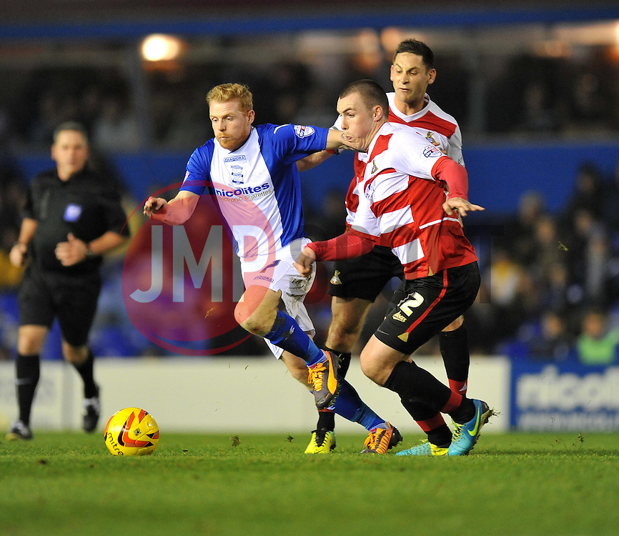 Birmingham City's Chris Burke chases down the ball under pressure from Doncaster Rovers' Luke McCullough - Photo mandatory by-line: Alex James/JMP - Tel: Mobile: 07966 386802 03/12/2013 - SPORT - Football - Birmingham - St Andrews - Birmingham City v Doncaster Rovers - Sky Bet Championship