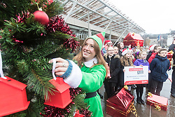 """Campaigners from Shelter Scotland raise awareness of their campaign """"Homelessness - Far From Fixed"""" outside the Scottish Parliament in Edinburgh. They are joined by carol singers from Corstorphine Primary School, a Christmas tree and a giant snakes and ladders board game - Chance Not Choice - which illustrates how life chances affect people's ability to keep a roof over their head.<br /> <br /> Pictured: Amanda Donaldson from Shelter Scotland"""