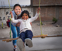 AREQUIPA, PERU - APRIL 3, 2014: Volunteer playing with kid in the community of Flora Tristan for HOOP Peru. HOOP Peru is a NGO fully committed to breaking the cycle of poverty by empowering the Flora Tristan families through enhancing their education.