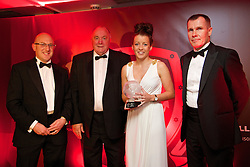 CARDIFF, WALES - Monday, October 6, 2014: Wales' Angharad James is presented with the Women's Young Player of the Year Award by Fosters' Chris Middleton (L), FAW President Trefor Lloyd-Hughes (C) and Wales women's manager Jarmo Matikainen at the FAW Footballer of the Year Awards 2014 held at the St. David's Hotel. (Pic by David Rawcliffe/Propaganda)