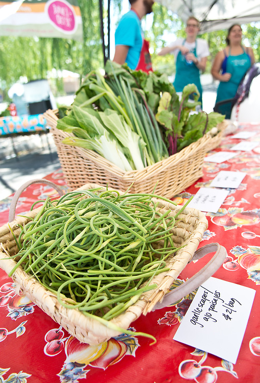 The Mobile Farmers' Market sold garlic scapes, bok choy, beets, turnips and other fresh food during their South Valley stops, which included Presbyterian Medical Group at 3436 Isleta Blvd. SW, Tuesday, June 6, 2017.  (Marla Brose/Albuquerque Journal)