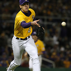 2009 February 20: LSU pitcher Louis Colman throws to first base for an out during a NCAA baseball match up between the #1 ranked LSU Tiger and the unranked Villanova Wilcats at the newly constructed Alex Box Stadium in Baton Rouge, Louisiana..
