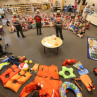 Adam Robison | BUT AT PHOTOS.DJOURNAL.COM<br /> Park Rangers, Eric Holcomb, Chris Gurner and Jason Letson, talk about water saftey to kindergarteners at Saltillo Primary School Wednesday morning.